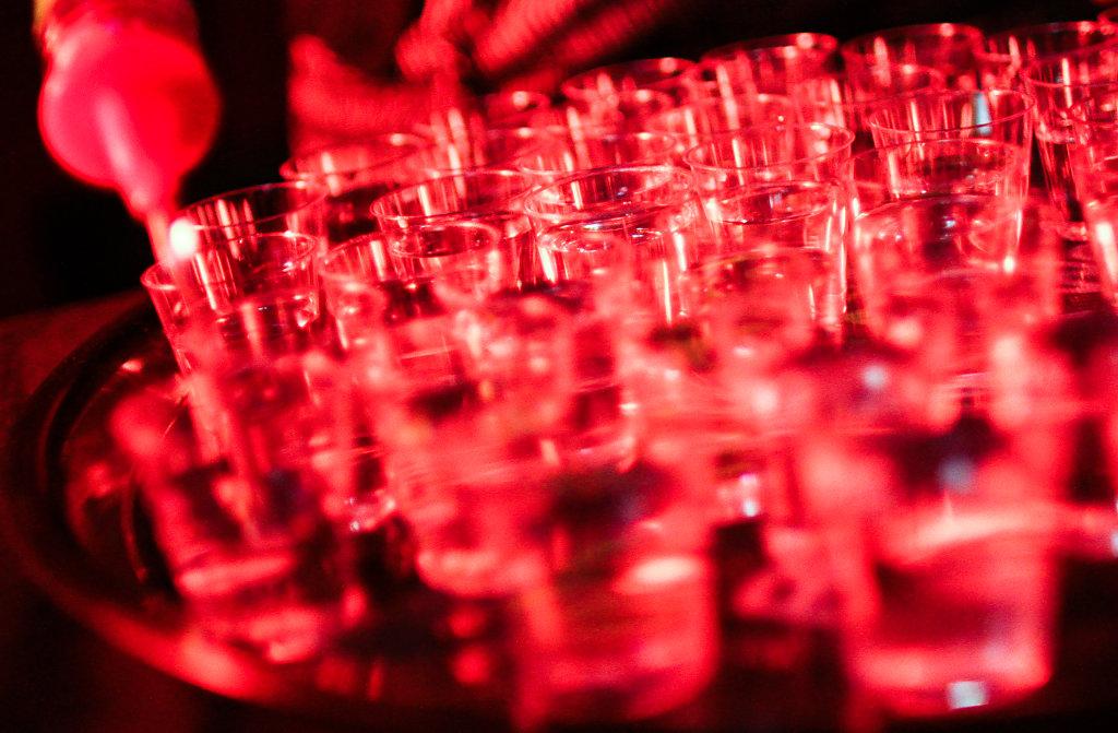 shot glasses in red light