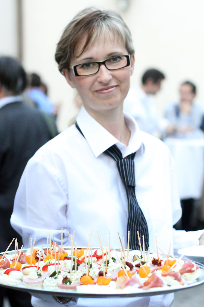 service of a conference , a woman serving snacks