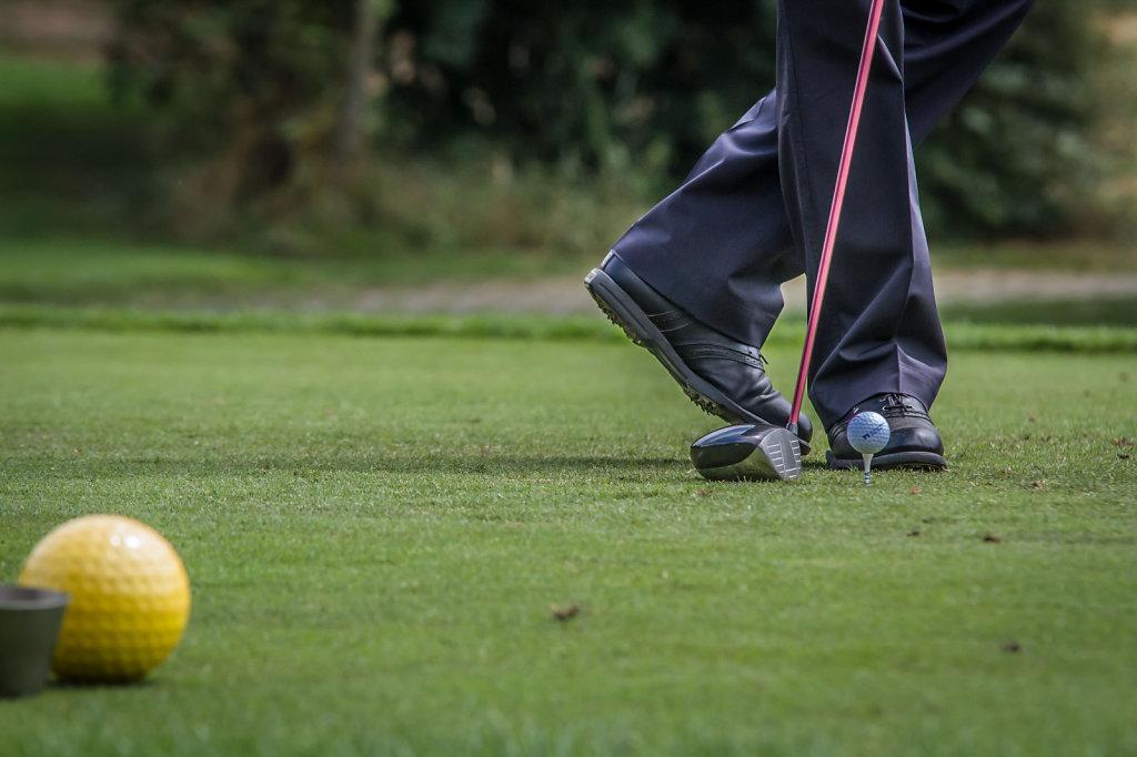 Golf event, men playing golf impression