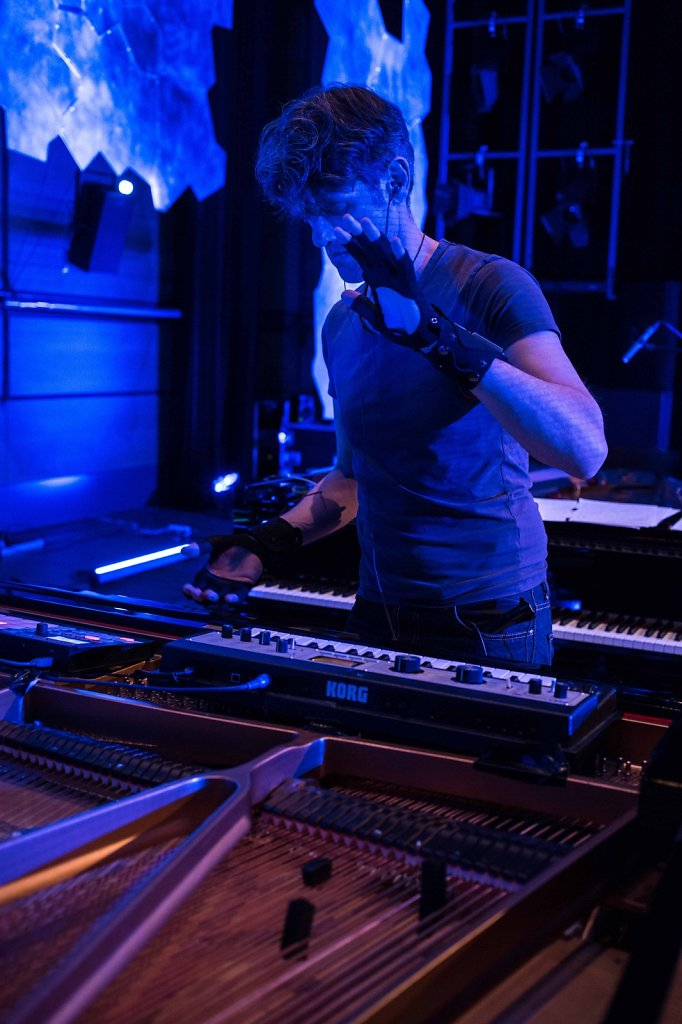 musician is experimenting with music on yamaha clavier and electronic gloves